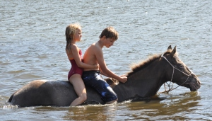 Me and Patrick riding on Texas in the lake.