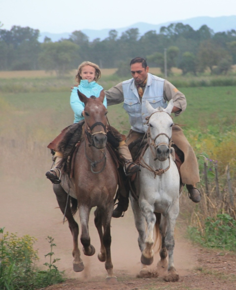 Alex at a gallop - check out the smile