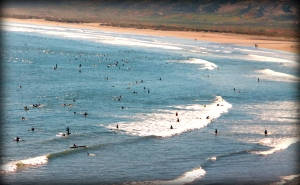 Surfers at the beach - from our deck
